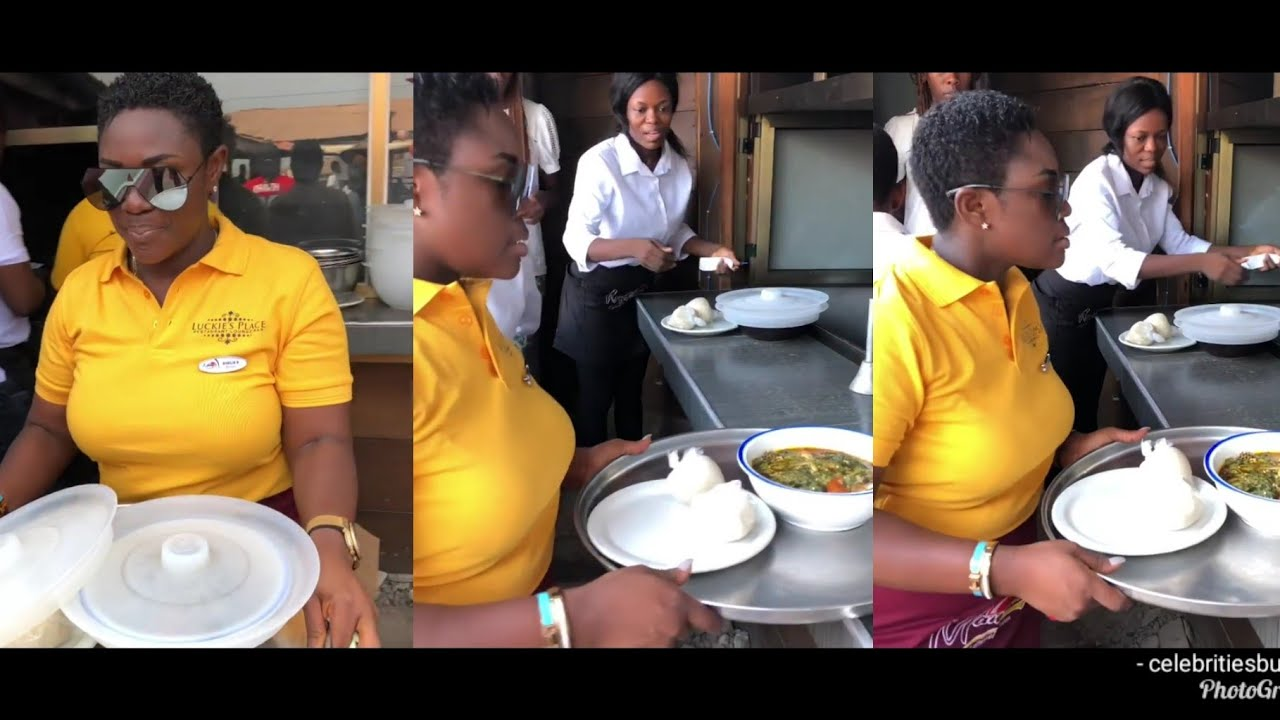 Emelia Brobbey serving food at luckie lawson's place