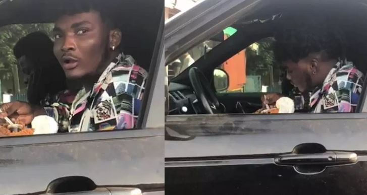 AMG Business signee, Mawuli Younggod with all his money seen eating 'road side' food