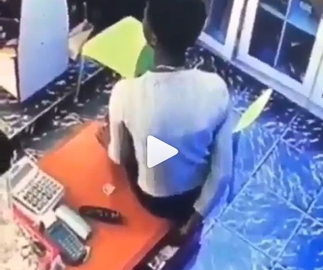 Lady captured on CCTV camera stealing money in a boutique