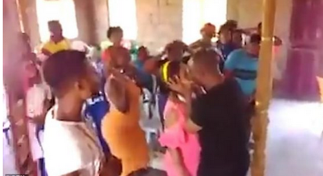 Hale luuuuuyaa: Popular Pastor Kissed Lady In Front Of Congregation In Attempt To Cleanse Her Of Evil Spirit [VIDEO]