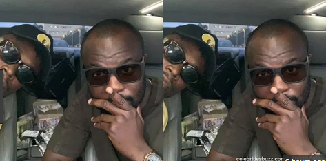 Rapper EL flaunts bundles of cedis in car back seat