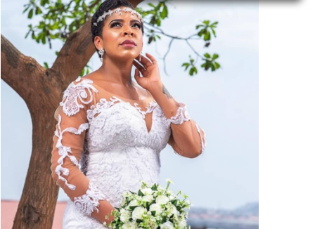 Tboss Fuels Pregnancy Rumors After Releasing Wedding -Themed Photos